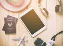 Hi tech traveler Gadgets traveling stuff blank tablet screen. Stock Photos