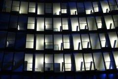 Hi-tech windows. Corporate night elevation with inner white lighting Royalty Free Stock Photo