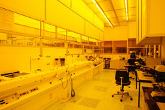 Hi-tech yellow light clean room. Facility for photolythic processes, nano techology and semi-conductor research royalty free stock photo