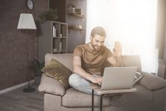 Young bearded man is having online conversation at home royalty free stock photos