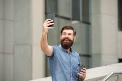 Hi there. Man taking selfie photo smartphone. Streaming online video call. Mobile internet. Tourist capture happy moment royalty free stock photos