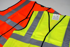 Hi Vis Vests. A yellow and an orange hi vis vest royalty free stock image