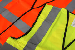 Hi Visibility Vests. A yellow and an orange hi vis vest Royalty Free Stock Photo