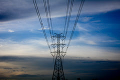 Hi-voltage electrical pylons against blue sky background. Hi-voltage electrical pylons against blue sky Royalty Free Stock Images