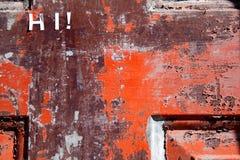 Hi on Weathered Red Door Stock Photo