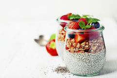 Сhia seeds vanilla pudding and berries on wooden rustic backgr Stock Photography