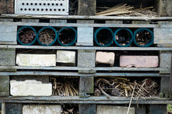 Hibernaculum for invertebrates. Man-made hibernaculum or invertebrates made from pallets, drainpipes and bricks Royalty Free Stock Photo