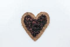 Hibiscus dried  lies at the heart made of burlap Stock Photography