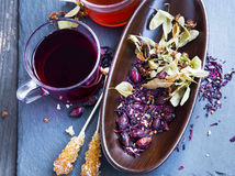 Hibiscus,linden and rosehip red tea cup with dried tea leaves an Stock Photography