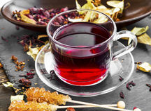 Hibiscus,linden and rosehip red tea cup with dried tea leaves an Royalty Free Stock Images