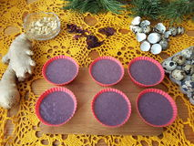 Hibiscus muffins red cakes cooking. Hibiscus muffins red cakes, cooking vegetarian food with hibiscus, ginger and quail eggs royalty free stock images