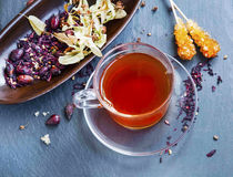 Hibiscus and rosehip red tea cup with dried tea leaves and fruit Stock Photo