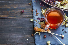 Hibiscus and rosehip red tea cup with dried tea leaves and fruit Royalty Free Stock Image
