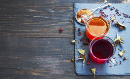 Hibiscus and rosehip red tea cup with dried tea leaves and fruit Stock Images