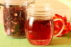 Hibiscus Tea. Tea with Hibiscus on a green background Stock Image