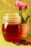 Hibiscus Tea. Tea with Hibiscus on a green background Royalty Free Stock Images