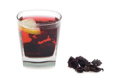Hibiscus tea. Glass of bright-red hot hibiscus tea. Isolated on white background Stock Image