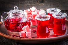 Hibiscus tea in glasses with turkish delight on rustic wooden background. Royalty Free Stock Image
