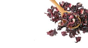 Hibiscus tea. Hibiscus tea in a wooden spoon on white background. Vitamin tea for cold and flu. stock images