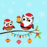 Hiboux de Noël sur la branche illustration de vecteur