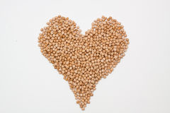 Hick-peas making a hearth Royalty Free Stock Photos