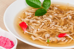 Сhicken broth with pieces of chicken Stock Photos