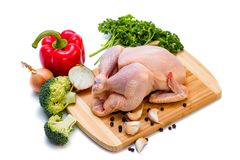 Ð¡hicken carcass, green parsley, onion and garlic on a board, on a white background. stock photo