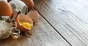 Сhicken eggs in a box. On a wooden background Stock Photo