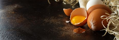 Сhicken eggs close up. On a dark background Royalty Free Stock Photography