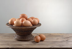 Hicken eggs in a wicker bowl Royalty Free Stock Photos