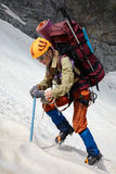 Hicker with backpack and ice-axe royalty free stock photos