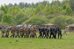 Hicking squad attack the village. RUSSIA, CHERNOGOLOVKA - MAY 17: Unidentified men in military uniform attack the civil village on History reenactment of battle Royalty Free Stock Photos