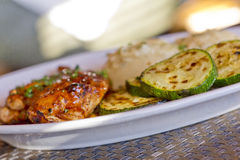 Hickory Bourbon Chicken. With grilled zucchini and mashed potatoes Stock Photography