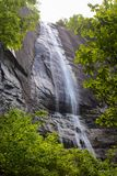 Hickory Nut Falls framed by spring foliage at Chimney Rock State Park in North Carolina. Hickory Nut Falls framed by fresh spring foliage at Chimney Rock State stock images
