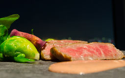 Hida Beef. Slices of top grade Japanese Hida beef with orange sauce and garnishes Stock Photos