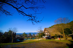 Hida Folk Village Hida No Sato. With blue sky in spring season, Takayama, Japan. An open air museum with over 30 traditional houses from the Hida region Royalty Free Stock Image