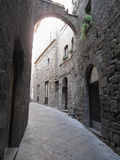 Hidden alley in Volterra village, province of Pisa . Tuscany, Italy Stock Photo