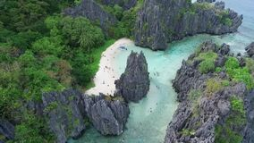 Hidden beach in Palawan, Sightseeing Place. Tour C in El Nido, Philippines. Secluded Locale with Towering Rock Formations,