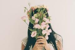 Hidden behind flowers Stock Photo