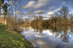 Hidden Bridge. Landscape of the river Loire in France on a calm and sunny wnters day Royalty Free Stock Photo