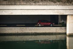 Hidden car. A car parked on bank of river stock photography