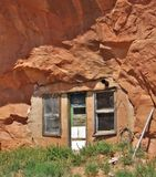 Hidden Cave Dwelling. If you look carefully when driving the dirt roads in the remote canyon areas near Moab, Utah, you might spot a dwelling built into a Stock Photo