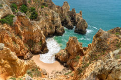 Hidden Cliffside Beach Along Coast Stock Photos
