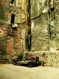 A hidden corner of Istanbul. Ruined and abadoned buildings with hardly damaged classic car Stock Image