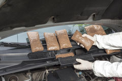 Hidden drugs in a vehicle compartment. Drug smuggled in a car's engine compartment stock photography