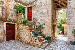 Hidden gem in Trogir. One of many streets in old part of Trogir, that is showing the soul of the town Stock Images