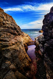 Hidden. Great view of the sea through rocks Stock Images