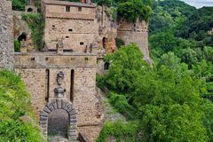 Sorano, small town in Tuscany hidden in the green. Hidden in the green, there are stone medieval houses of town Sorano in Tuscany royalty free stock photo
