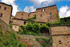 Sorano, small town in Tuscany hidden in the green. Hidden in the green, there are stone medieval houses of town Sorano in Tuscany royalty free stock photos