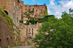 Sorano, small town in Tuscany hidden in the green. Hidden in the green, there are stone medieval houses of town Sorano in Tuscany stock photos